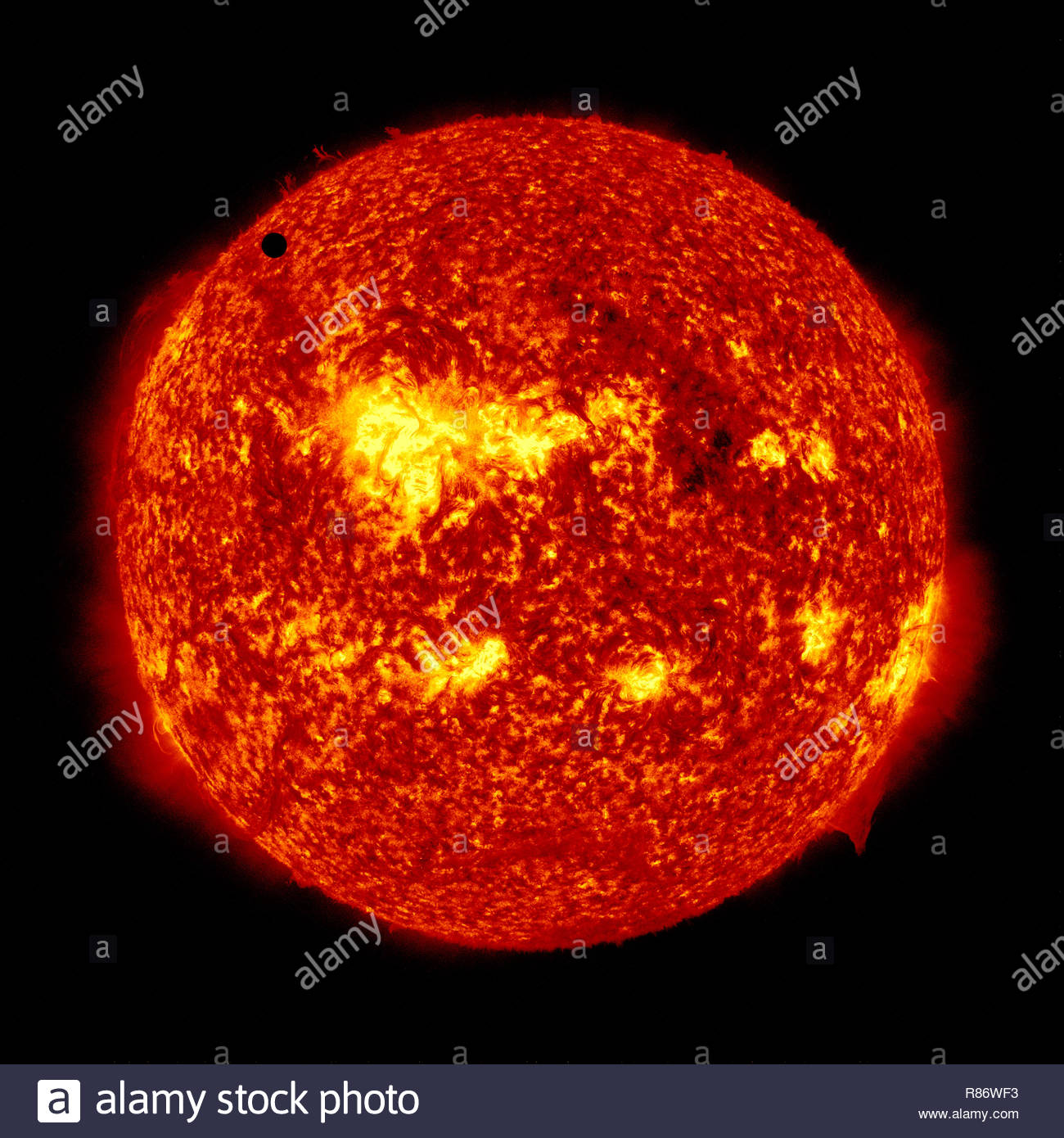 The Transit of Venus 2012. Planet Venus passes as a small dark spot in the face of the Sun. Raw images by NASA. Digitally enhanced by contributor - Stock Image