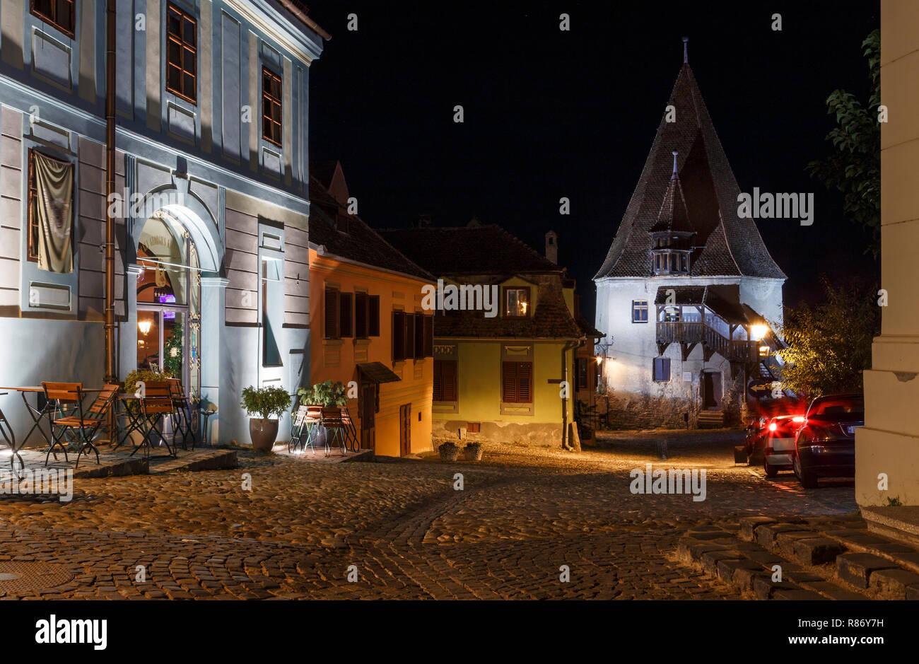 Old saxon town Sighisoara, Romania, night view of the Bastion Tower, Transylvania - Stock Image