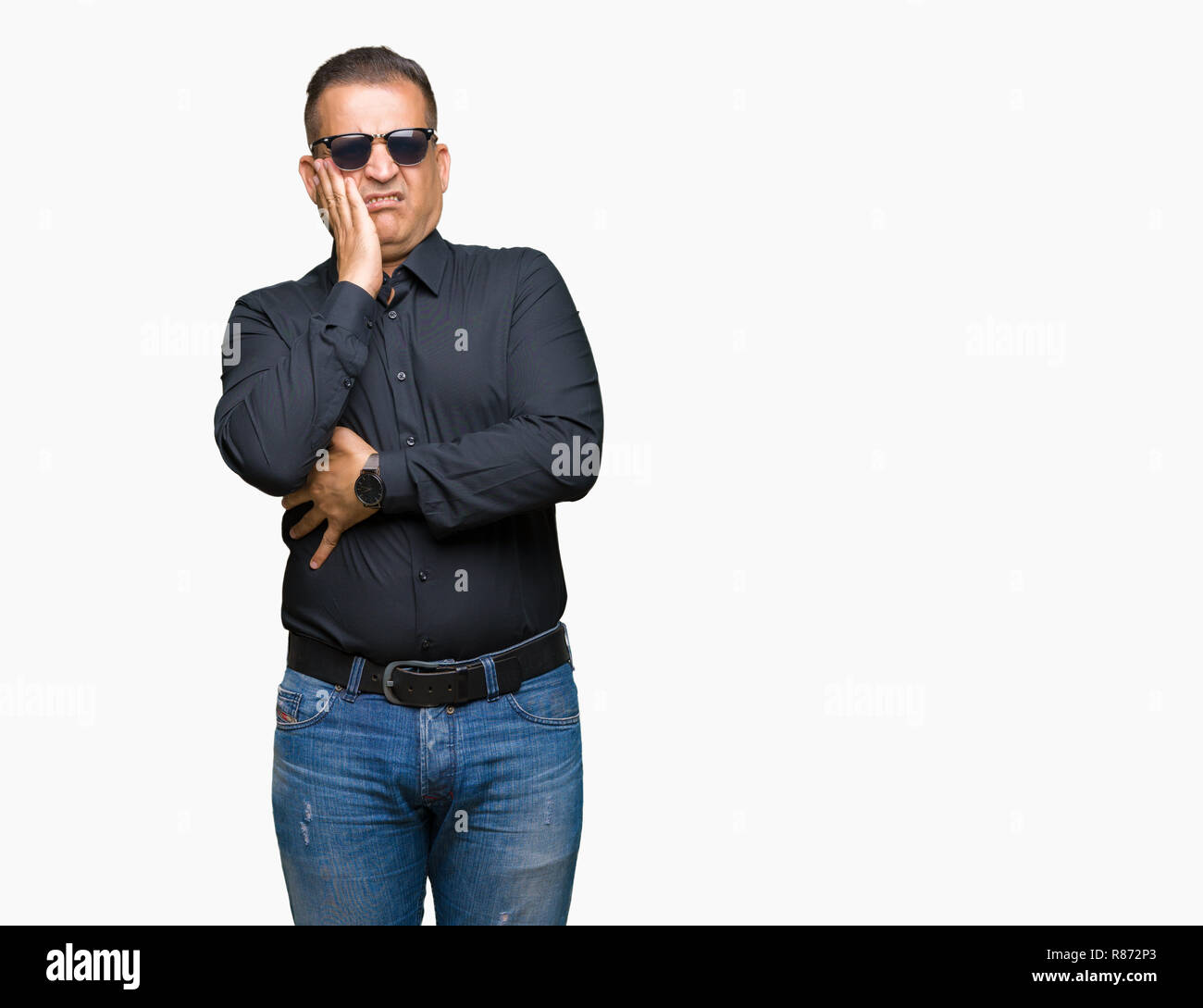 Middle age arab man wearing sunglasses over isolated background thinking looking tired and bored with depression problems with crossed arms. Stock Photo