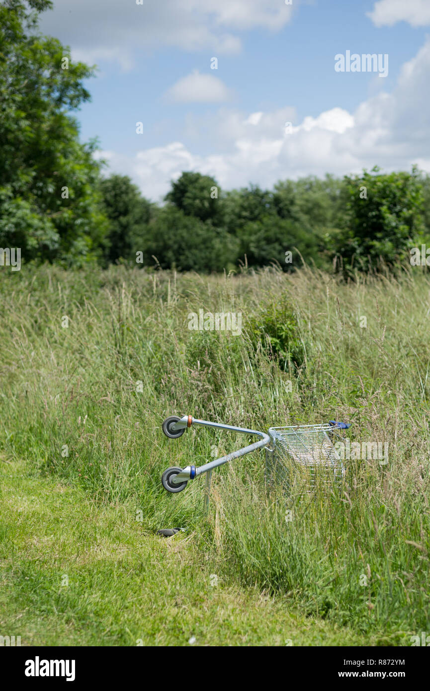 Abandoned shopping trolley in the afflent Hampshire town of Petersfield - Stock Image