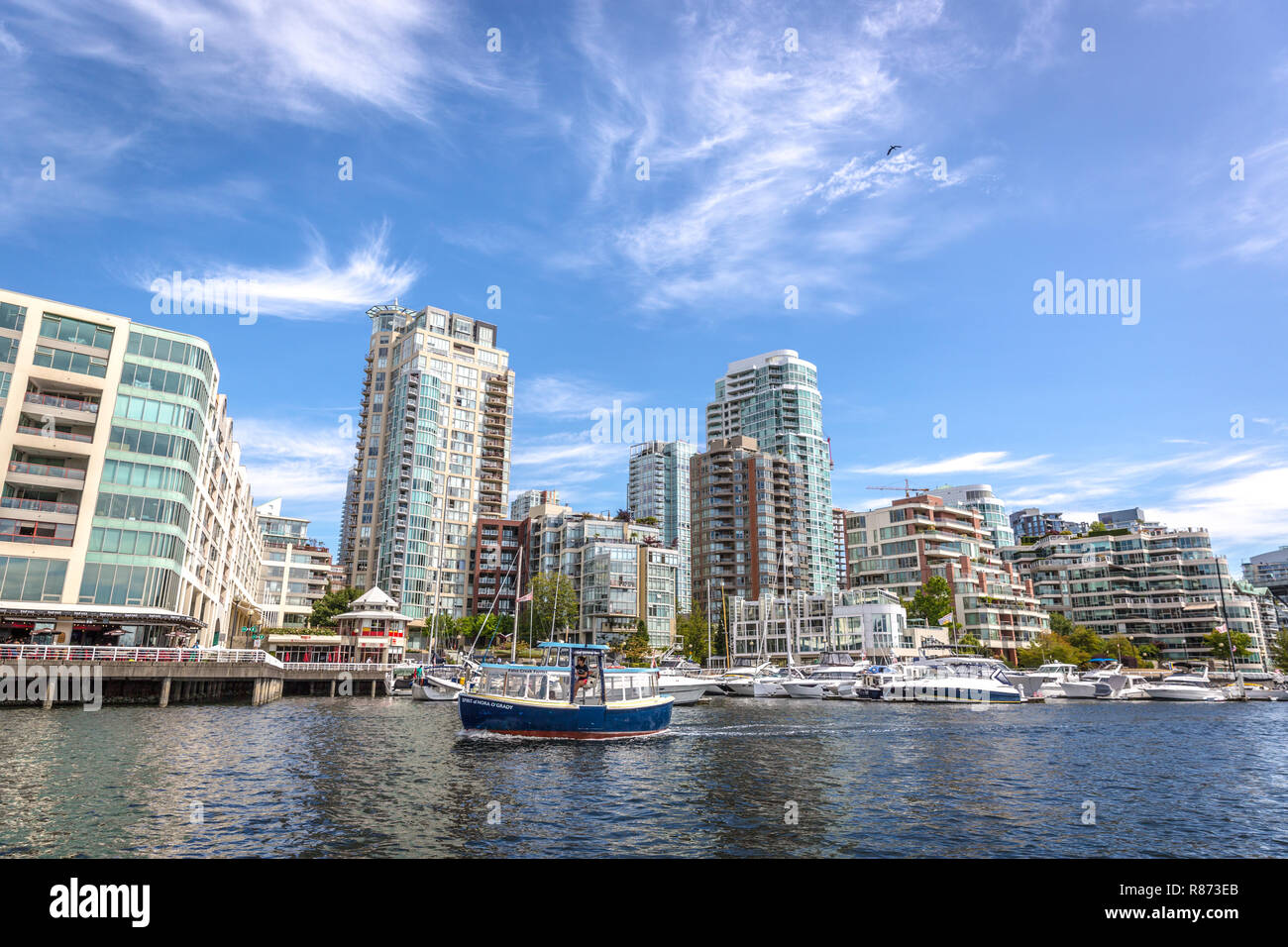 Vancouver, Canada - Set 20th 2017 - Plenty of boats in front of buildings in Vancouver during a blue sky day in Canada Stock Photo
