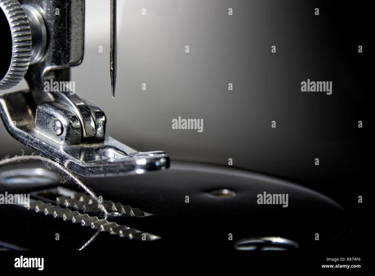 Get Needled: Macro photograph of part of a 1940's sewing machine. Sharp, detailed photo of the needle and pusher. Suitable office/hotel wall hanging. - Stock Image