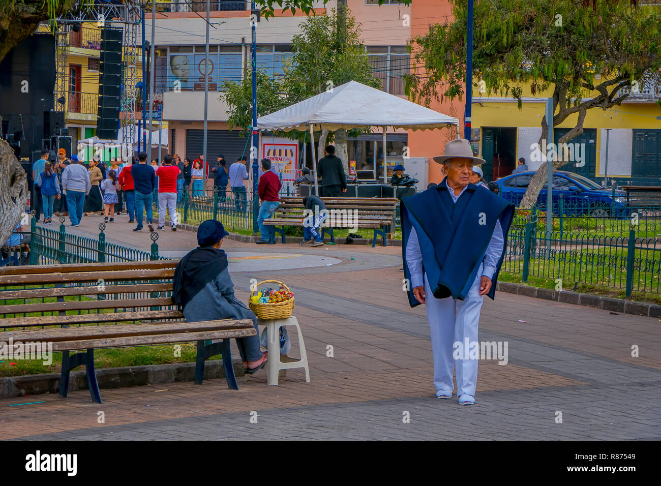 COTACACHI, ECUADOR, NOVEMBER 06, 2018: People in Calderon Park, Cotacachi, Ecuador, in front of Matriz Church Stock Photo
