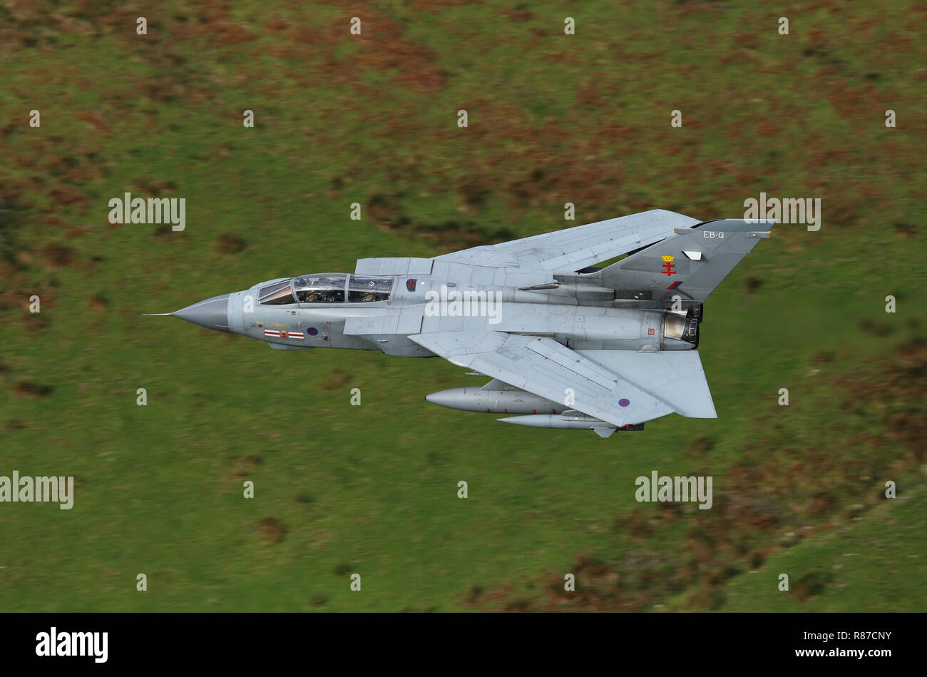 RAF Tornado GR4, serial no. ZA560, on a low level flight in the mach loop, Wales, UK.  The aircraft shows the markings of 41 Squadron. - Stock Image