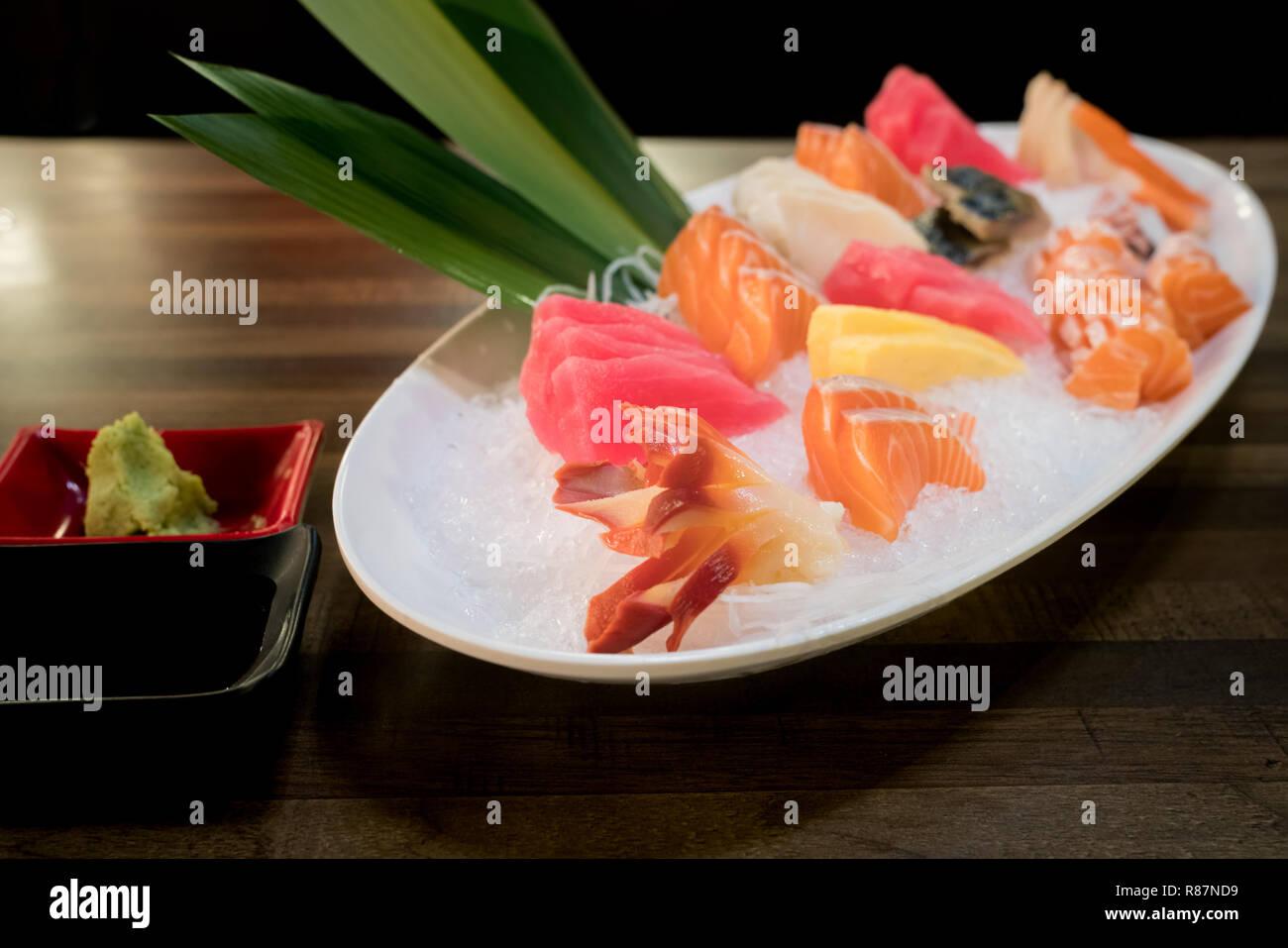 Mixed Sliced Fish Sashimi On Ice In White Bowl Sashimi Salmon Tuna