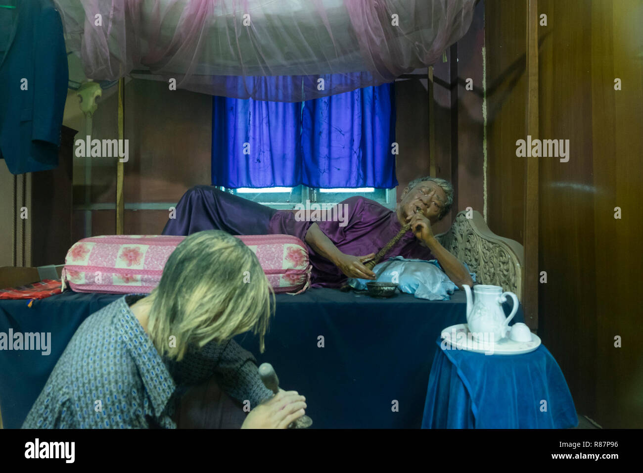 Exhibit showing the smoking of opium at the Drug Elimination Museum in Yangon, Myanmar. Stock Photo