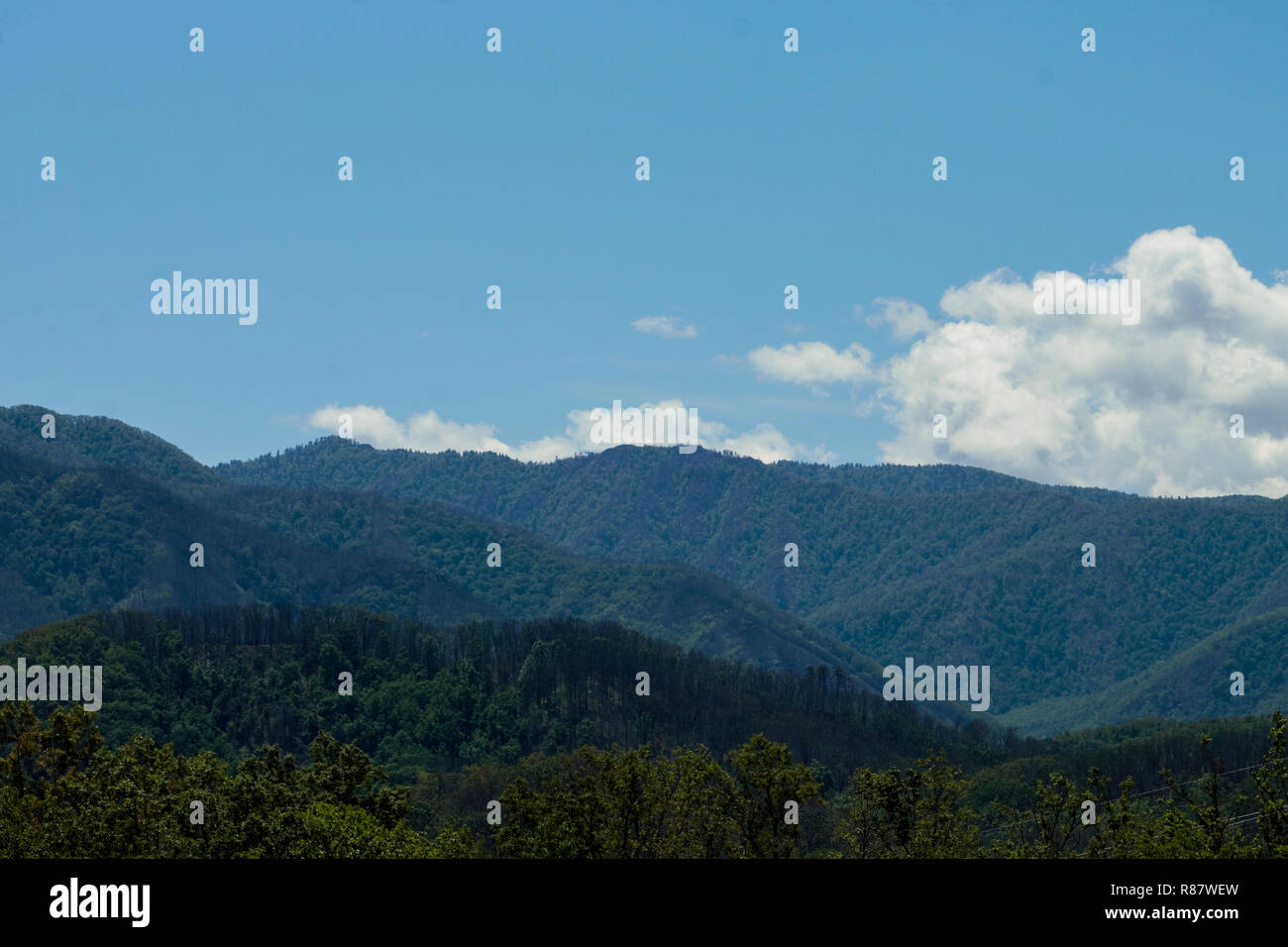 mountains against a blue sky - Stock Image