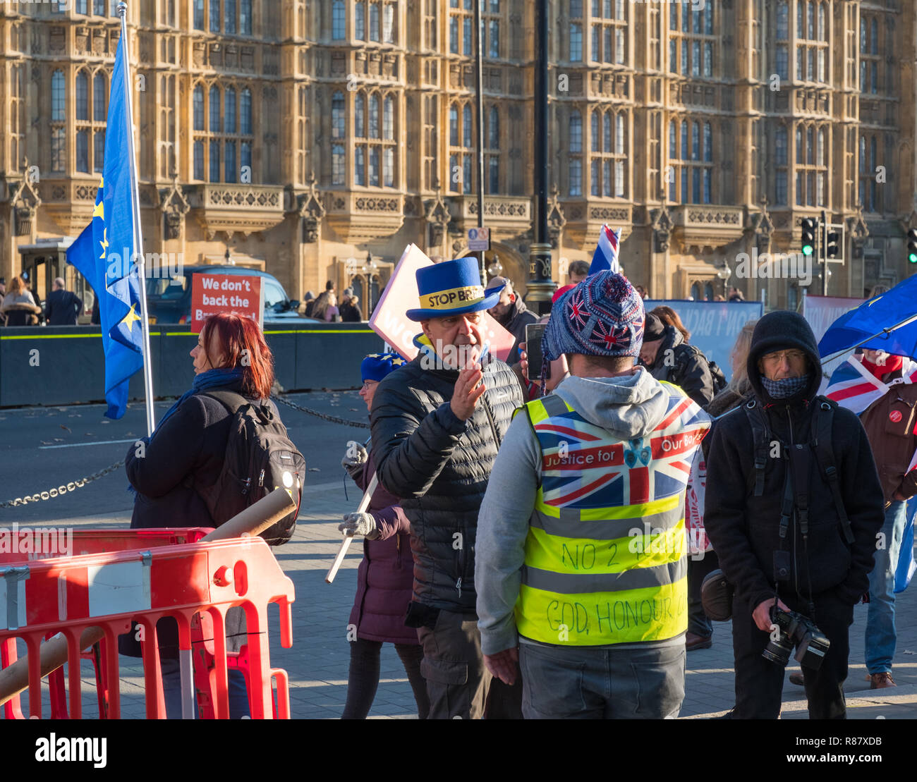 Brexit protest and argument between both leavers and remainers outside the Houses of Parliament, Abingdon Street, London - Stock Image