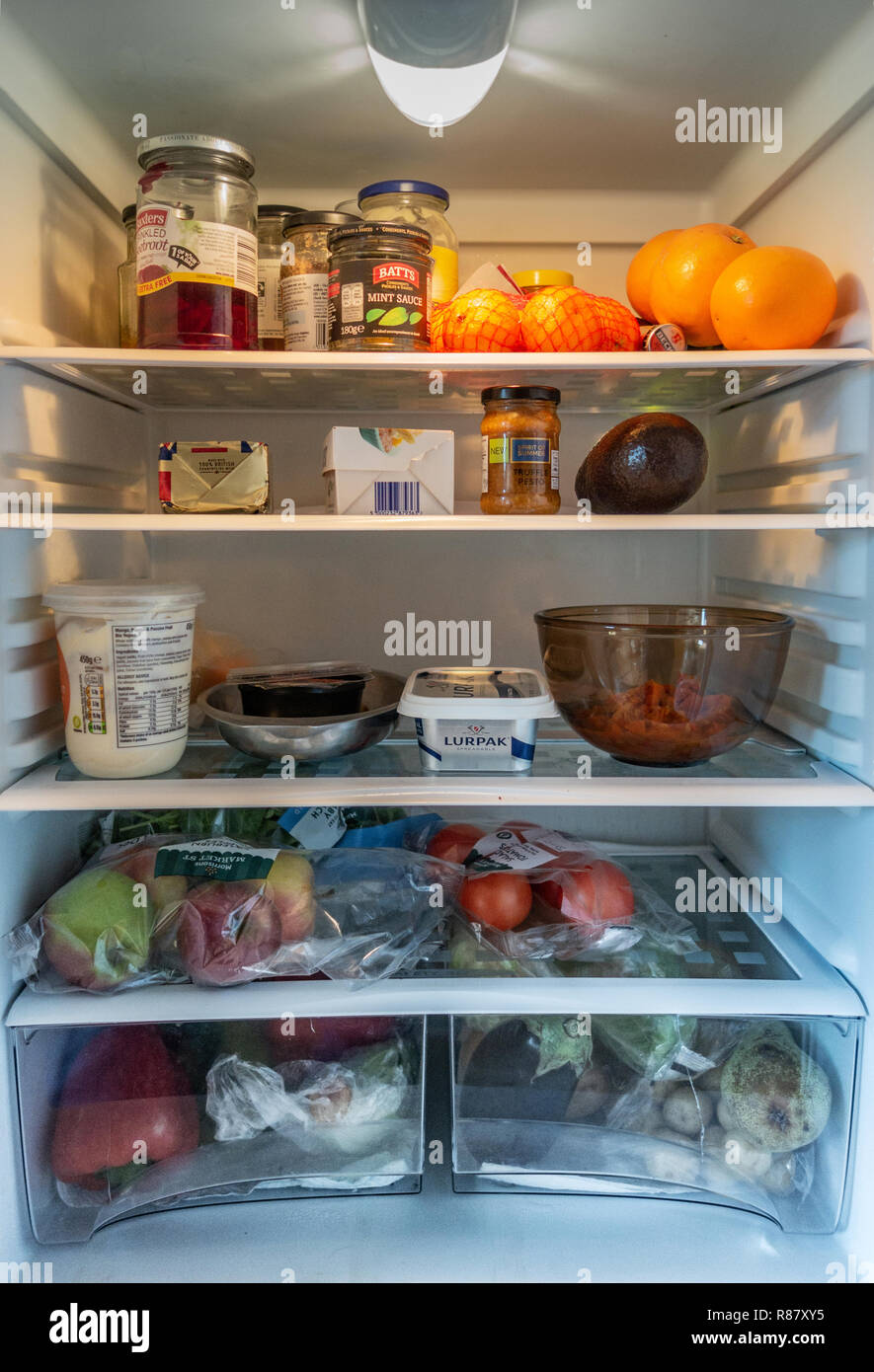 Inside view of a fridge and Contents owned by a 90 year old lady in England - Stock Image