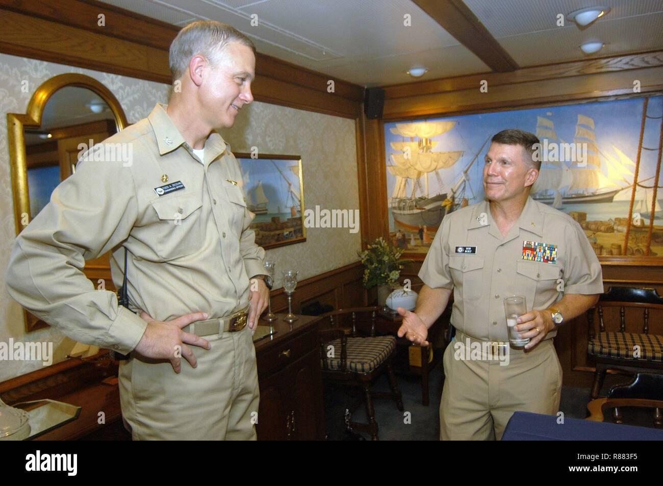 Capt. Todd A. Zecchin (left) welcomes Rear Adm. (Upper Half) Robert F. Burt during his visit aboard USS John F. Kennedy (CV 67). - Stock Image