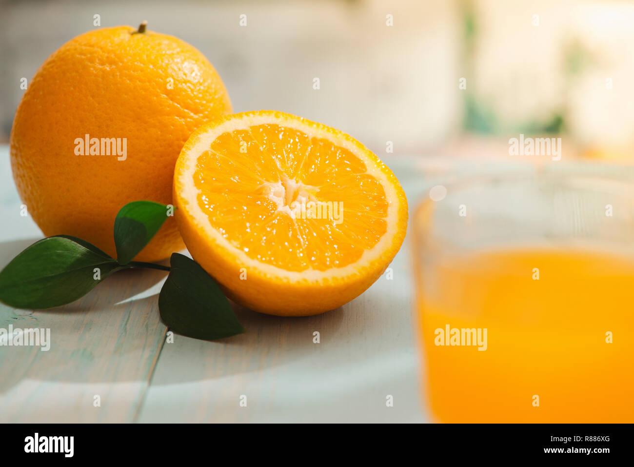 Oranges isolated cut set on wooden base - Stock Image