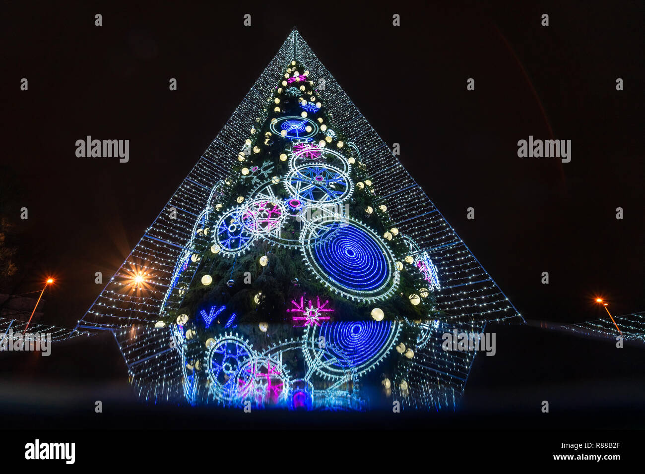 Decorated Christmas tree in Vilnius with reflection on mobile phone screen Stock Photo