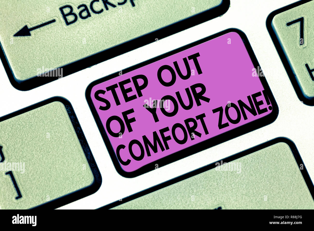 Conceptual hand writing showing Step Out Of Your Comfort Zone. Business photo showcasing Do different things leave the routine Keyboard key Intention  Stock Photo