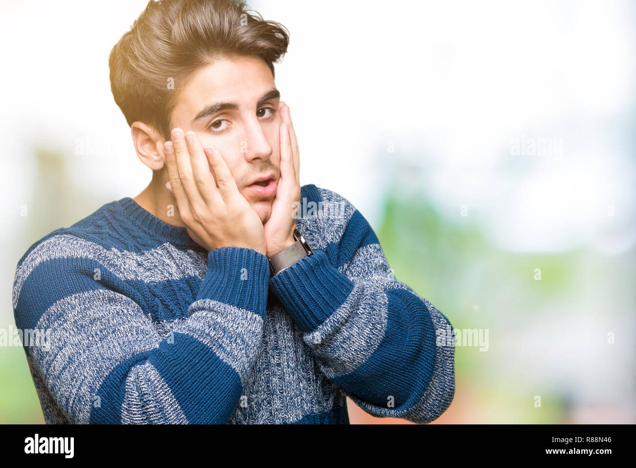 Young handsome man over isolated background Tired hands