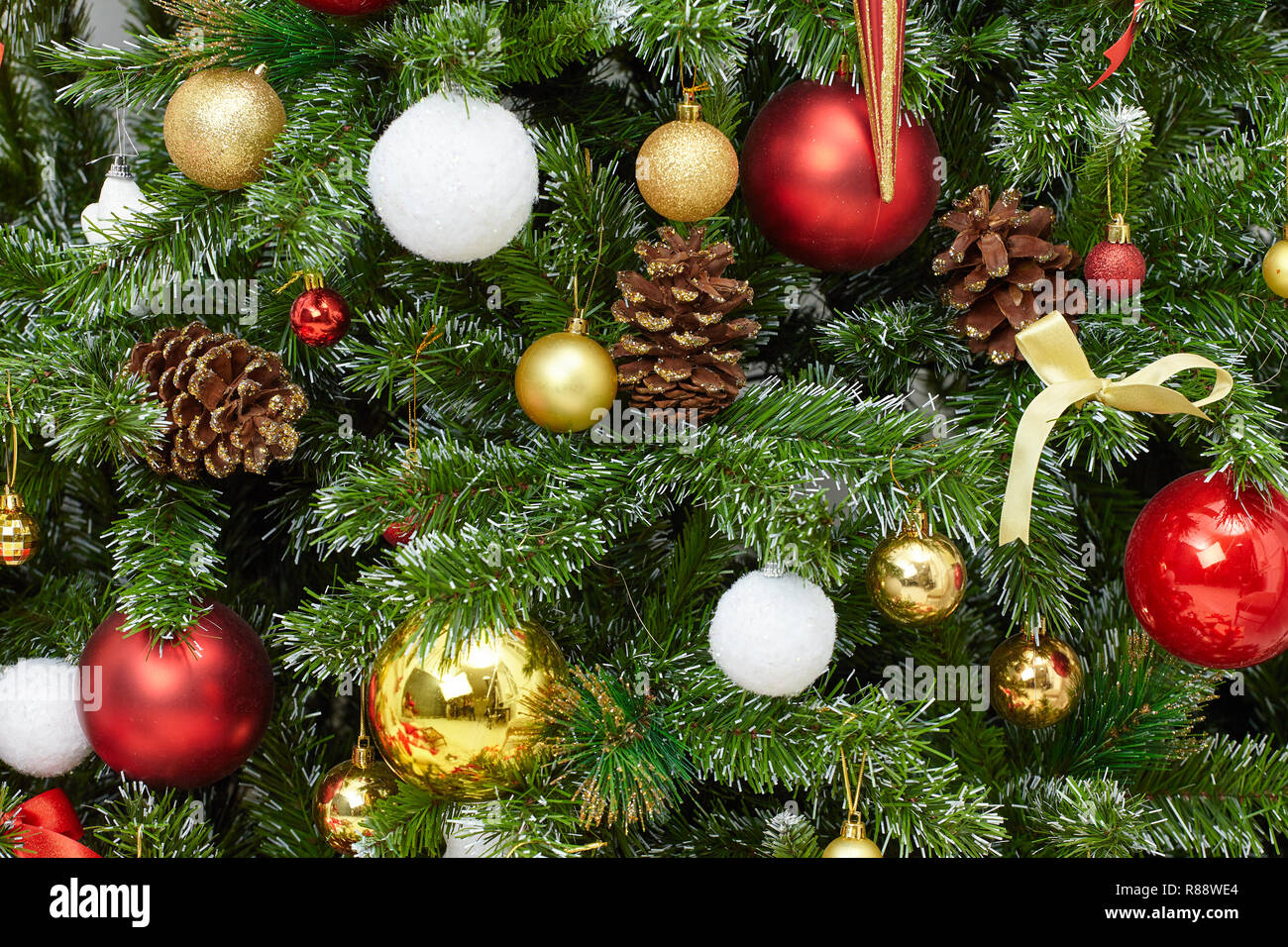 Closeup of a decorated Christmas tree background Stock Photo