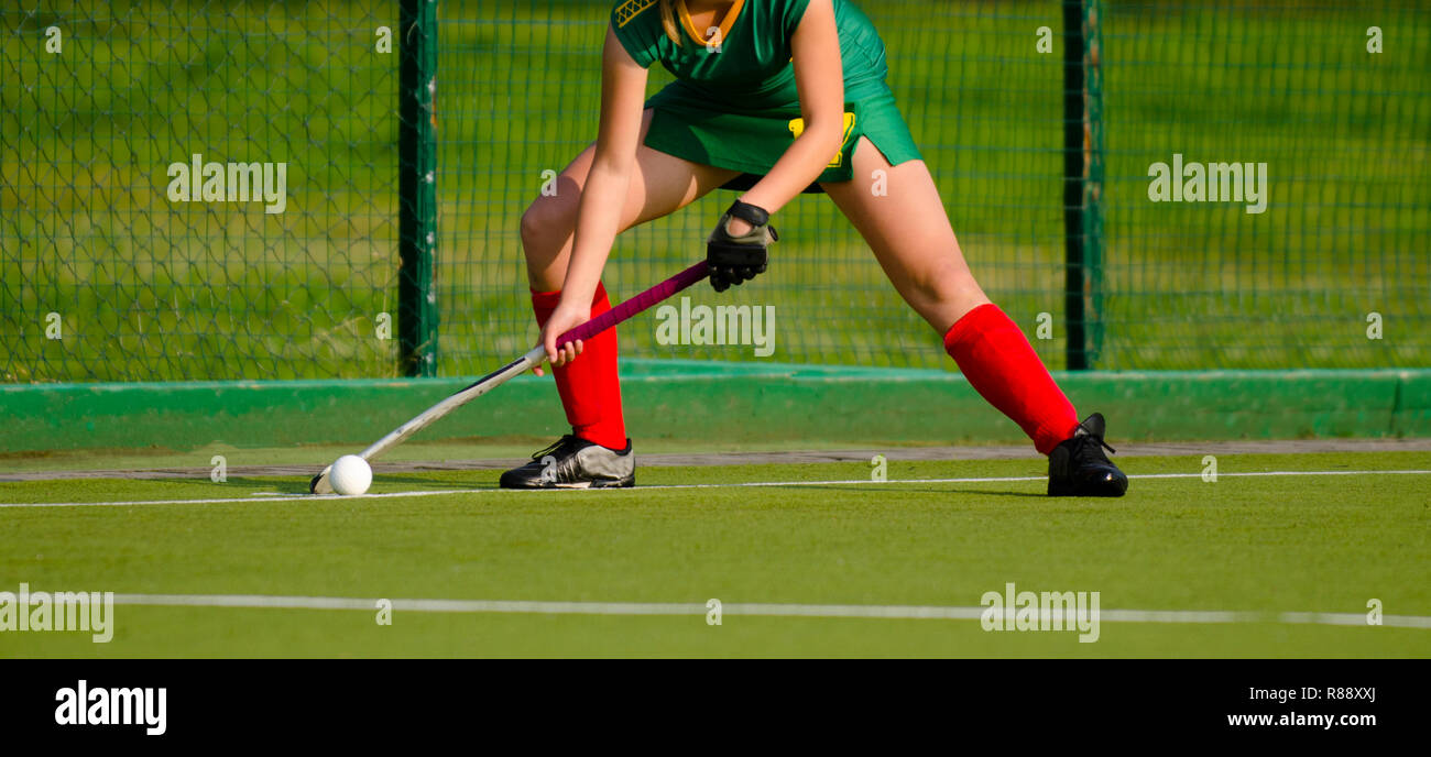 Field Hockey player, ready to pass the ball to a team mate - Stock Image