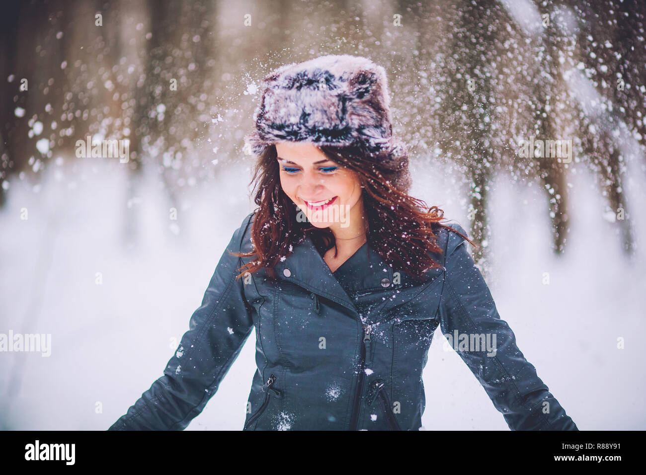 girl against the background of the winter forest Stock Photo