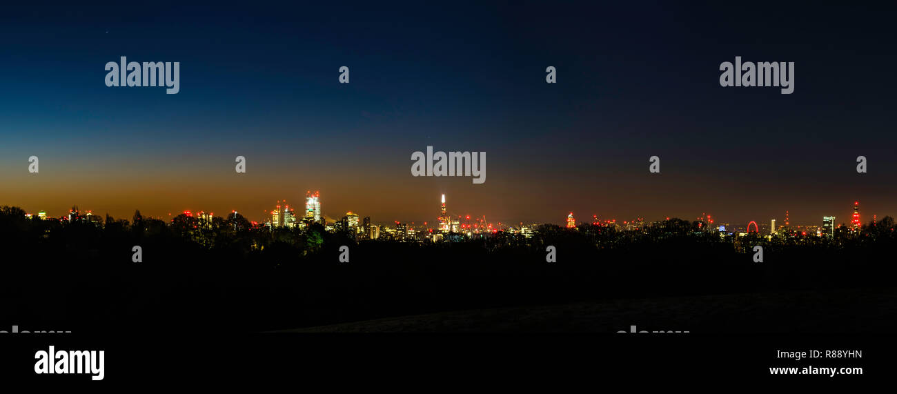 Panoramic view of dawn over the London skyline from Hampstead Heath, London, UK - Stock Image