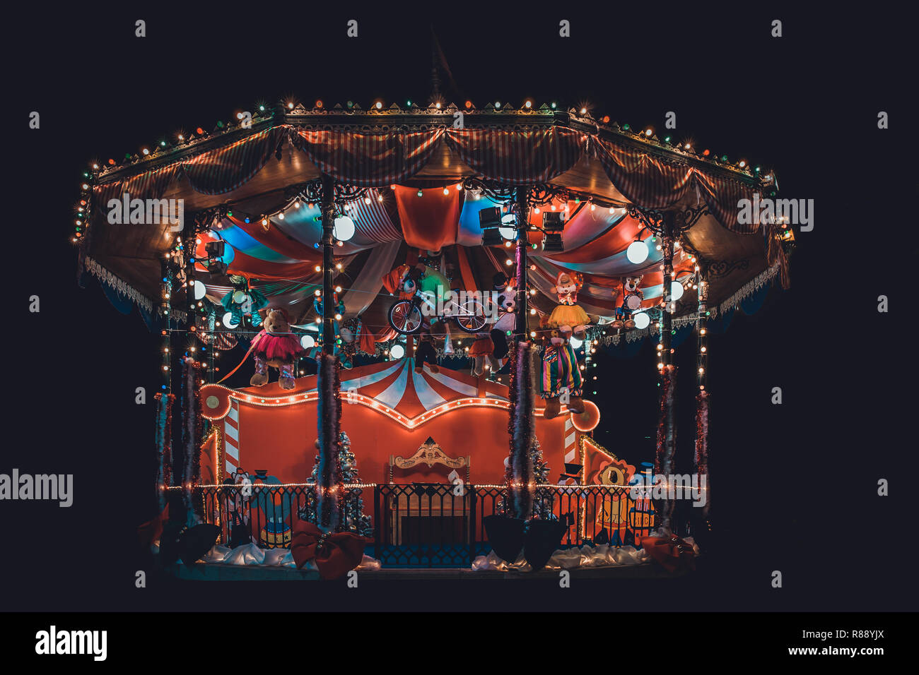 Isolated colored bandstand carousel with toys - Stock Image
