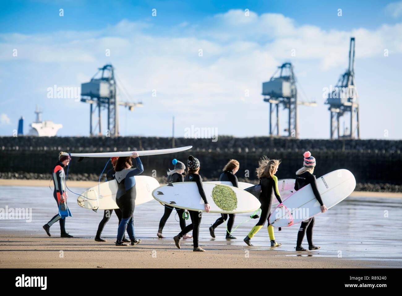 The women's surf community 'Surf Senioritas', members at Aberavon Beach near Port Talbot, S. Wales UK Stock Photo