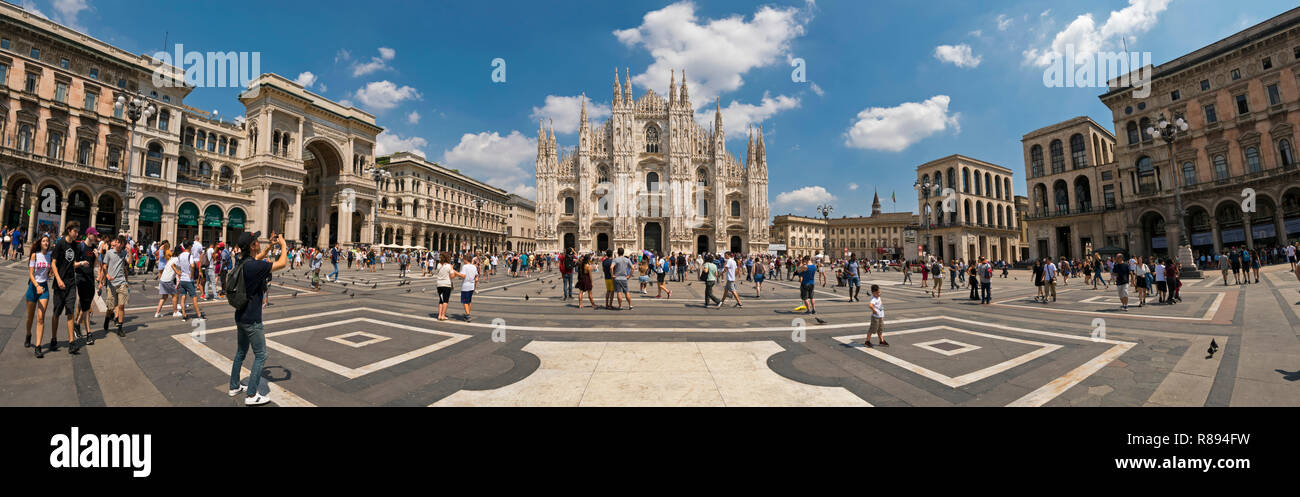 Horizontal streetview of Piazza del Duomo, including Milan cathedral and Galleria Vittorio Emanuele II in Milan, Italy. - Stock Image