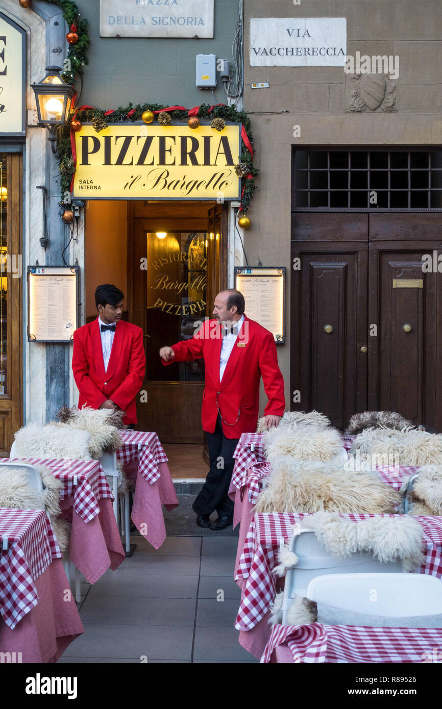 Two waiters chatting before restaurant opens - Stock Image