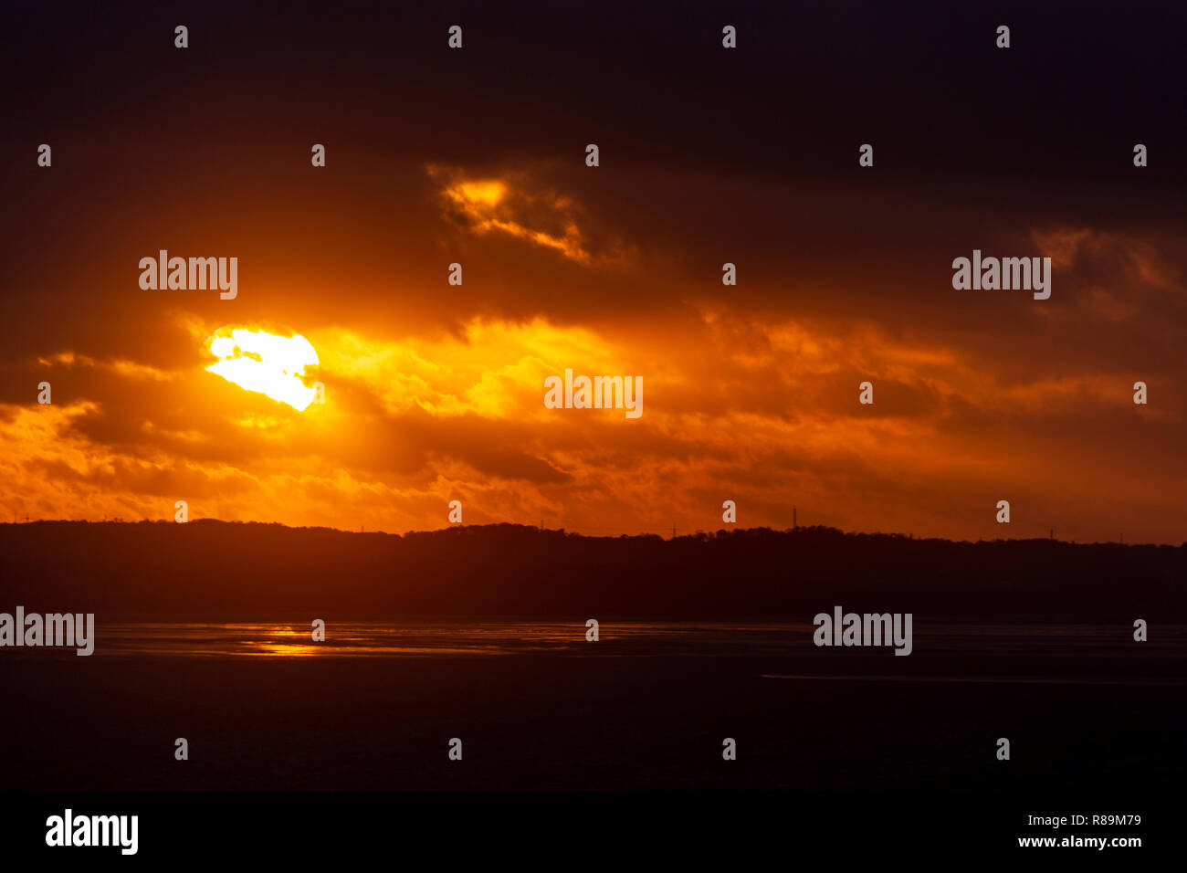 Sunset with clouds over the Irish Sea at Llandudno West Shore, North Wales Stock Photo