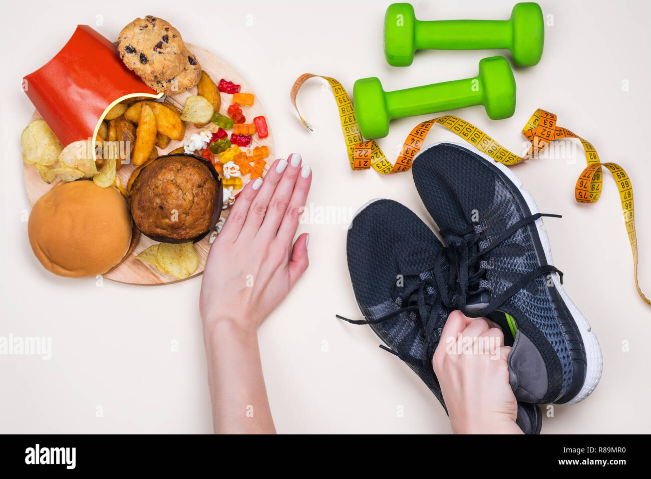 Junk food and sport accessories - Stock Image