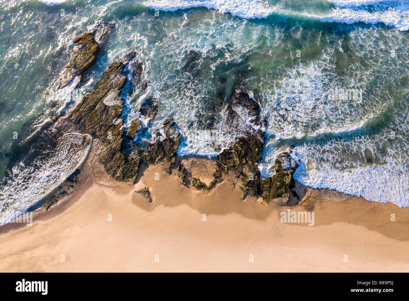 Aerial view of waves running across the rocks at Dudley Beach - Newcastle Australia - Stock Image