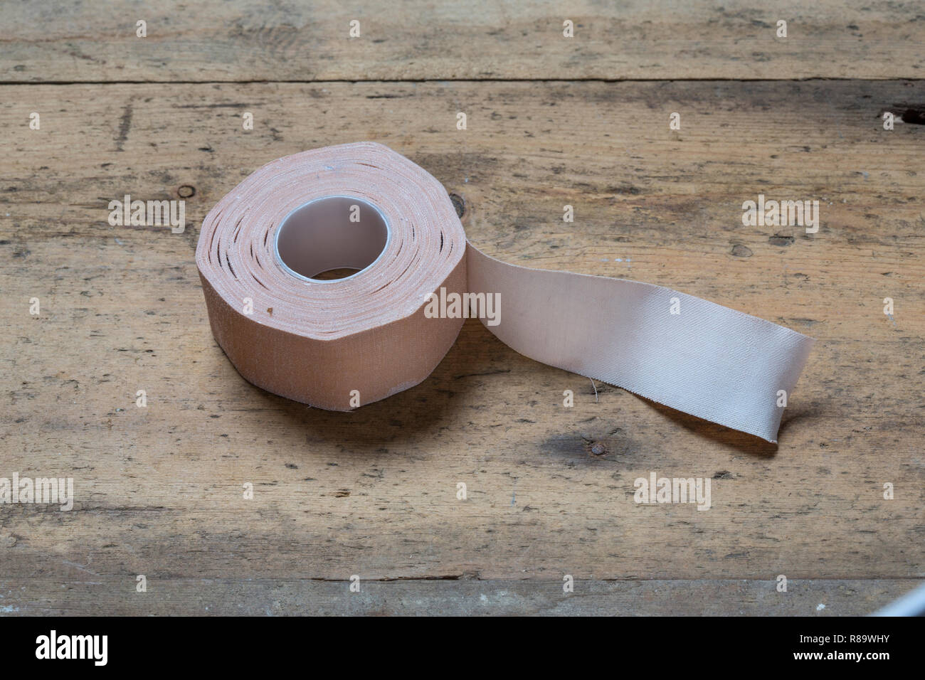 A roll of old medical sticky tape - Stock Image