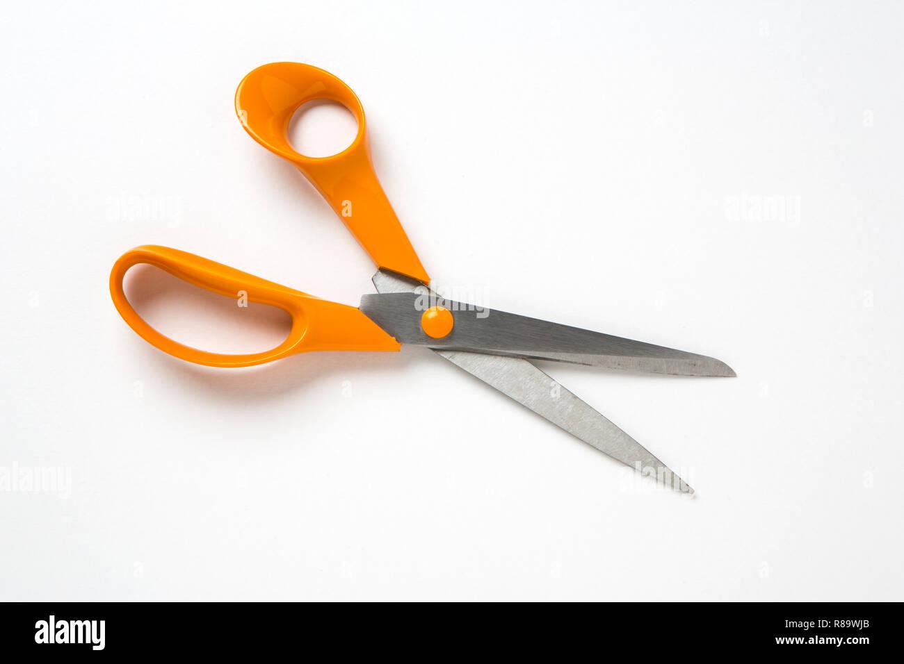Orange handled kitchen scissors - Stock Image
