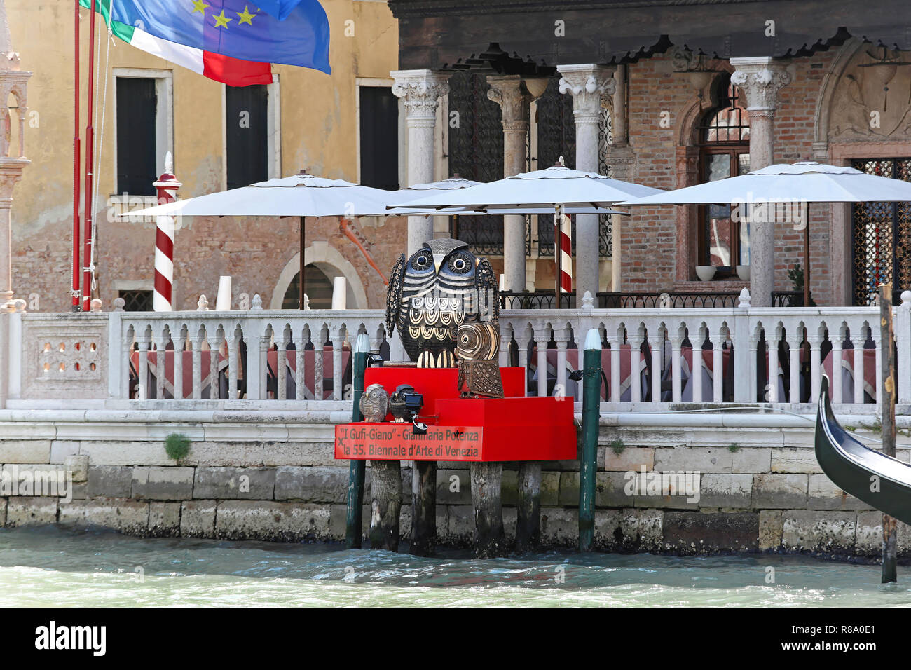 VENICE, ITALY - JULY 08: La Biennale in Venice on JULY 08, 2013. Bronze owls statues for 55th International Art Exhibition in Venice, Italy. - Stock Image