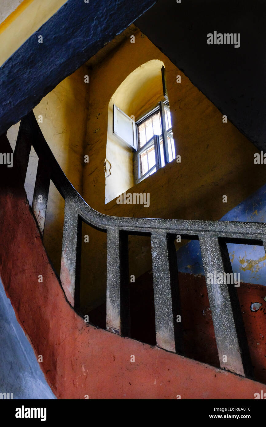 Prison stairways going up with a window - Stock Image