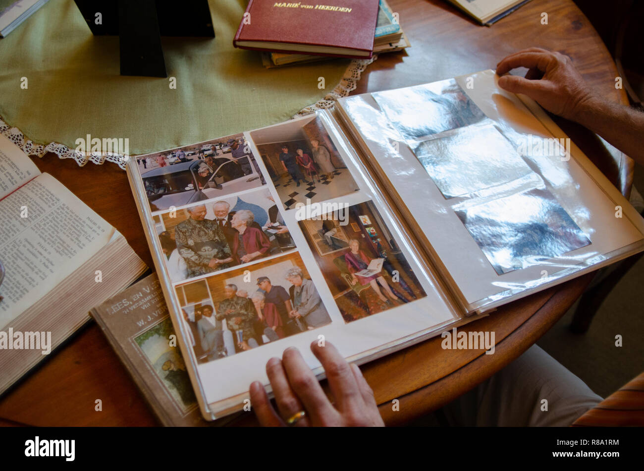 Carel Boshoff (junior) the grandson of H.F. Verwoerd, the mastermind of Apartheid, is looking at a photo album of a 1995 visit from South African President Nelson Mandela, in Orania, the Northern Cape, Friday, December 12, 2013. Photo: Eva-Lotta Jansson - Stock Image