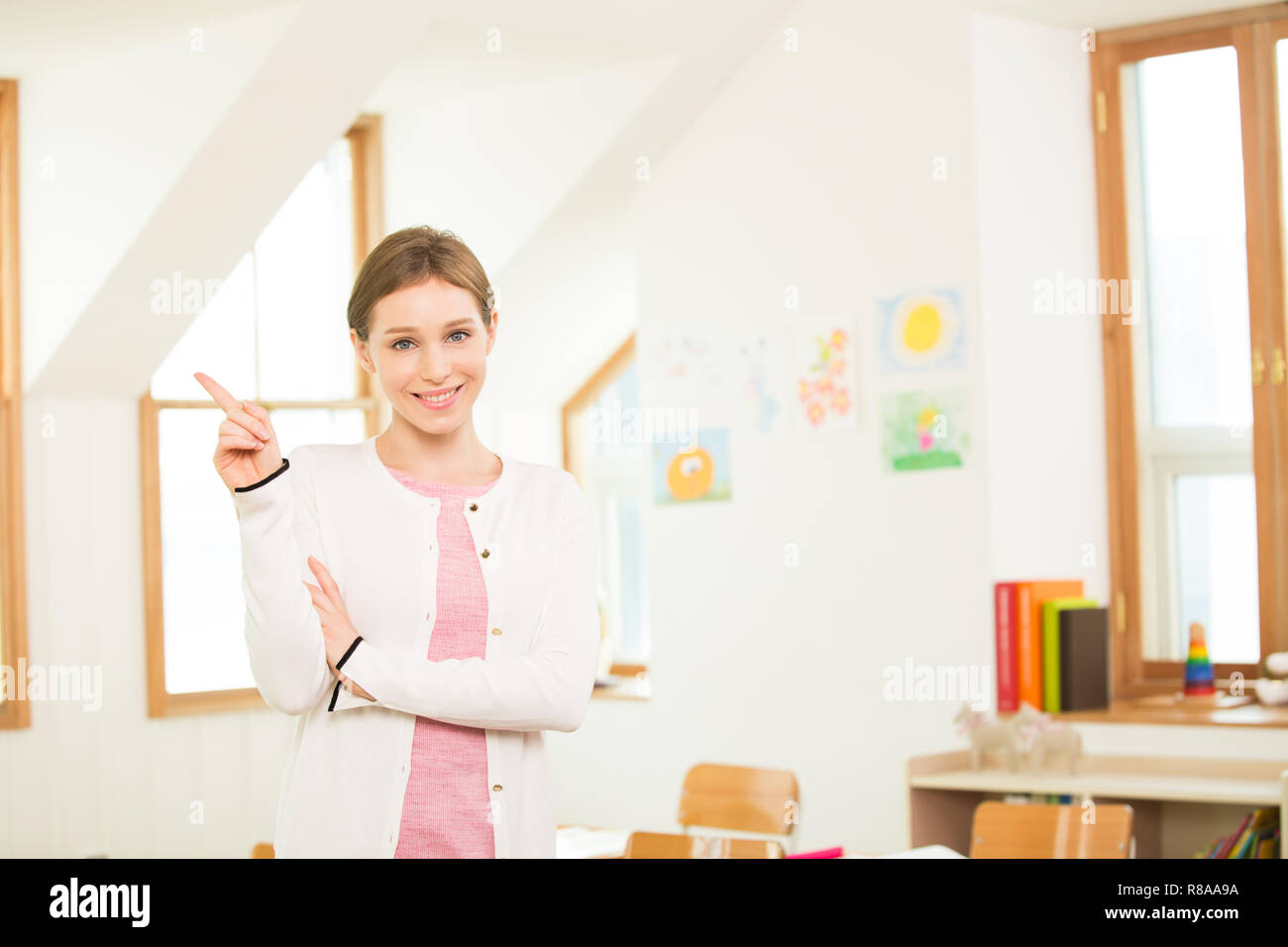Female Teacher In A Classroom - Stock Image