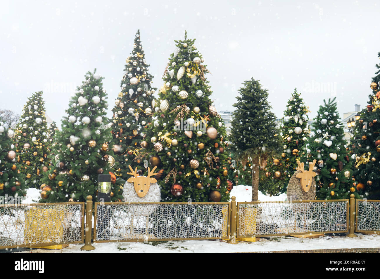 Christmas Toys Balls and Snowflakes on the Tree Christmas Fair - Stock Image