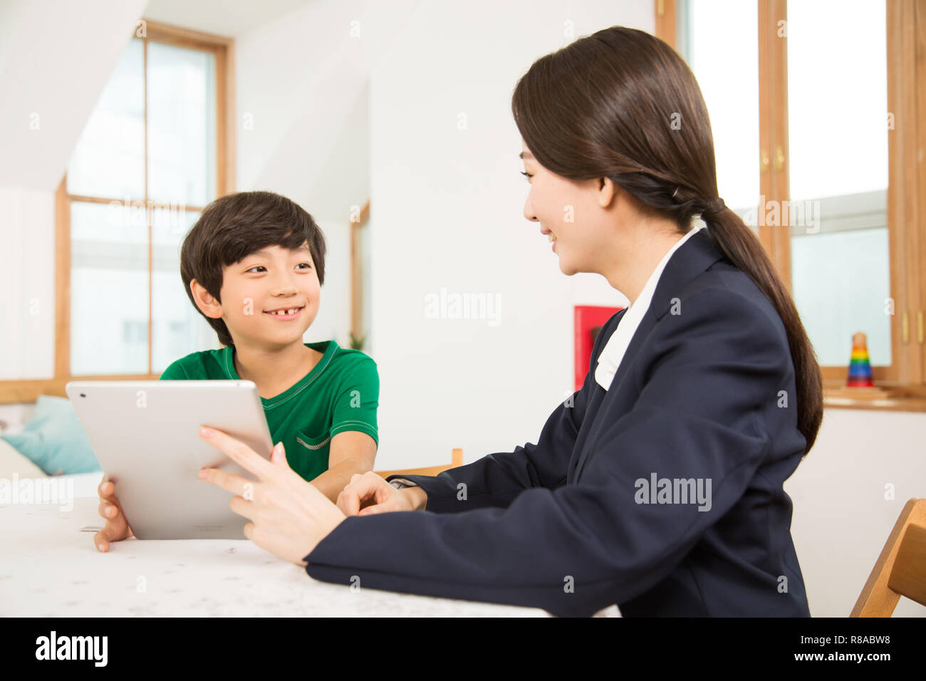 Young Student And A Female Teacher - Stock Image