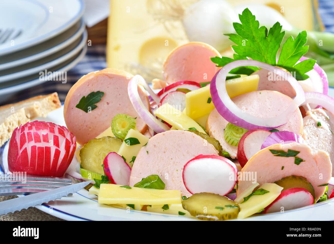 Bavarian sausage salad with cheese Stock Photo