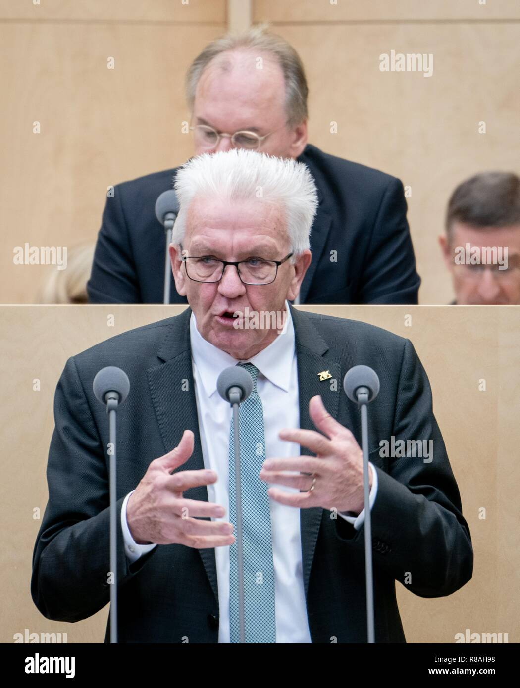 Berlin, Germany. 14th Dec, 2018. Winfried Kretschmann (Bündnis 90/Die Grünen), Minister President of Baden-Württemberg, speaks at the meeting of the Bundesrat. In the last session of the year, the regional chamber finally deals with several laws of the grand coalition, including tightening the rent brake, more further training, higher nursing care contributions in 2019, postponement of the ban on anaesthetised piglet castration. Credit: Kay Nietfeld/dpa/Alamy Live News - Stock Image