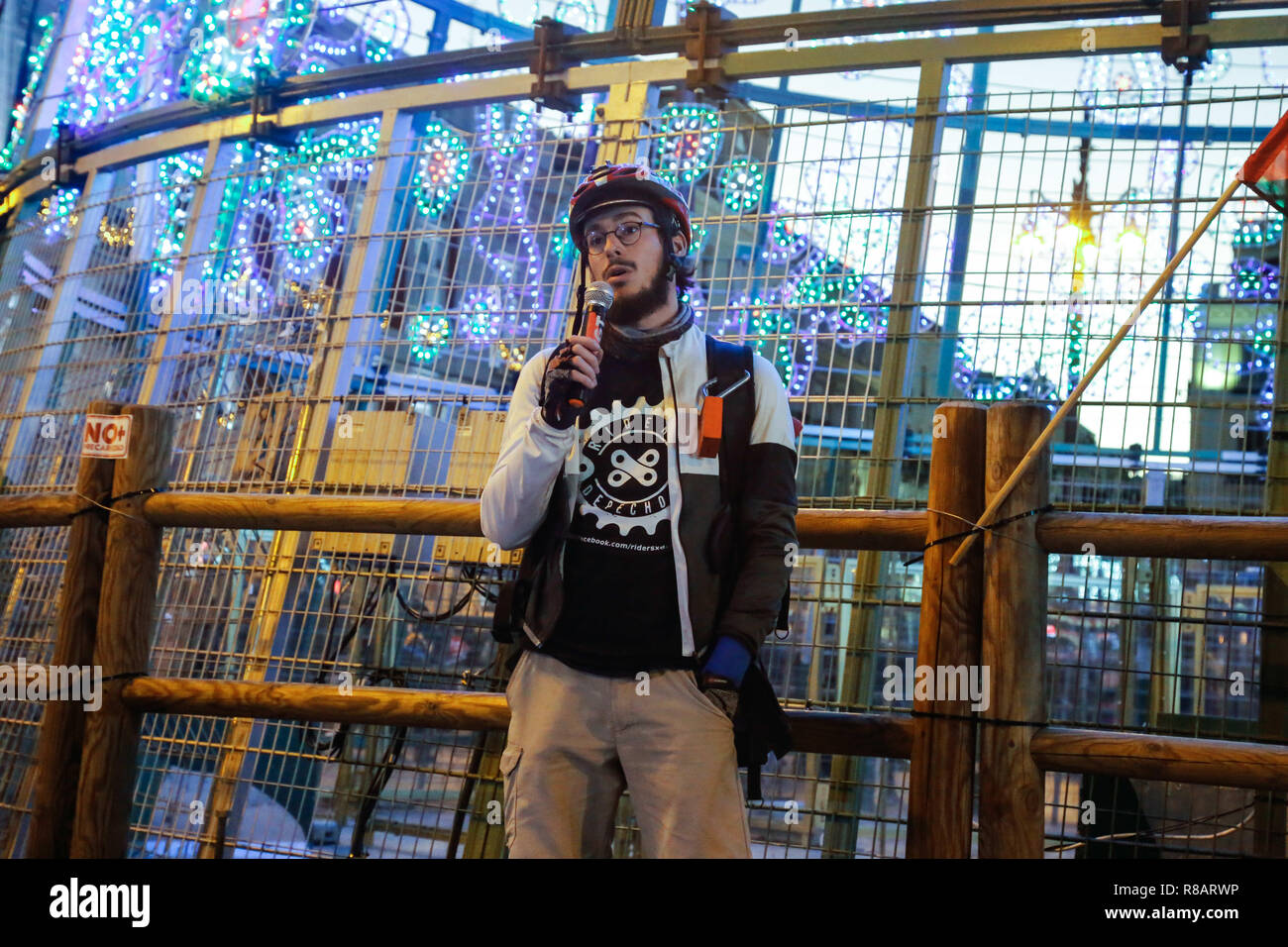Madrid, Spain. 14th Dec, 2018. Representative of the ''Riders Madrid'', affected by the false self-employed companies such as Deliveroo, Glovo or JustEat seen explaining their situation during the protest.Workers from various active strikes such as Carrefour, Inditex, Amazon or teleoperators in Spain and CGT (General Confederation of Labor) unionists protest against the new forms of labor exploitation such as garbage contracts, false self-employment, non-compliance with labor rights young people, etc. Credit: Lito Lizana/SOPA Images/ZUMA Wire/Alamy Live News - Stock Image
