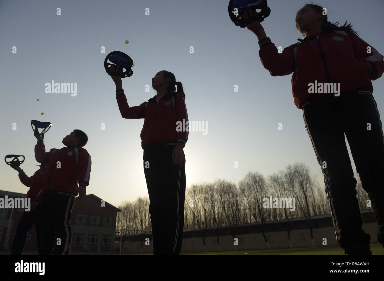 Gu'an, China's Hebei Province. 14th Dec, 2018. Students practise for a ball game at Nanzhaogezhuang primary school in Gu'an County, north China's Hebei Province, Dec. 14, 2018. Various extracurricular classes are provided in Nanzhaogezhuang primary school to enrich the school life of students. Credit: Lu Peng/Xinhua/Alamy Live News - Stock Image