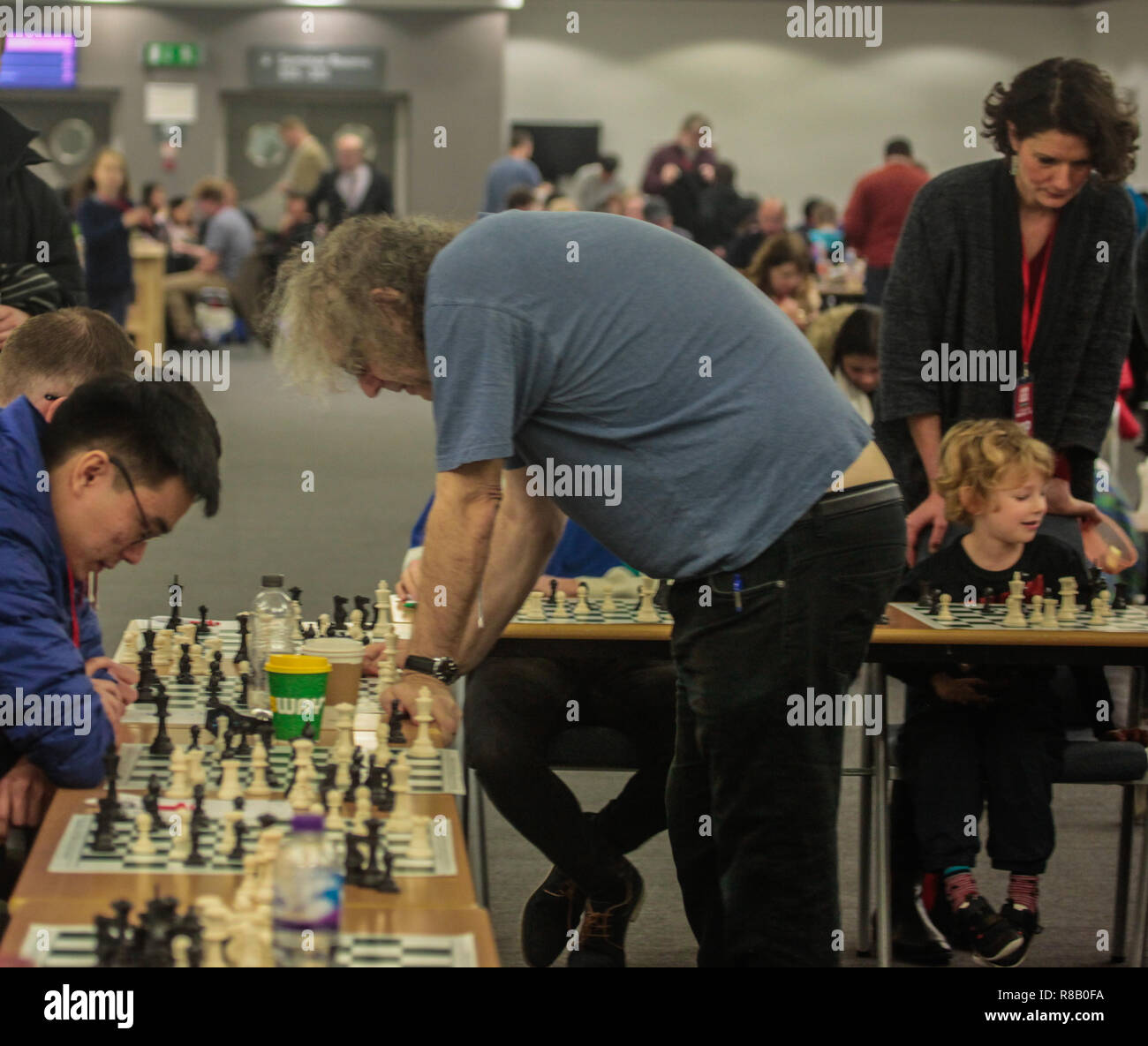 London UK 15 December 2018 British chess  Grandmaster Jon Speelman, giving  a simultaneous display over 20 boards at the London Chess Classic held in London Olympia 2018 Credit: Paul Quezada-Neiman/Alamy Live News - Stock Image