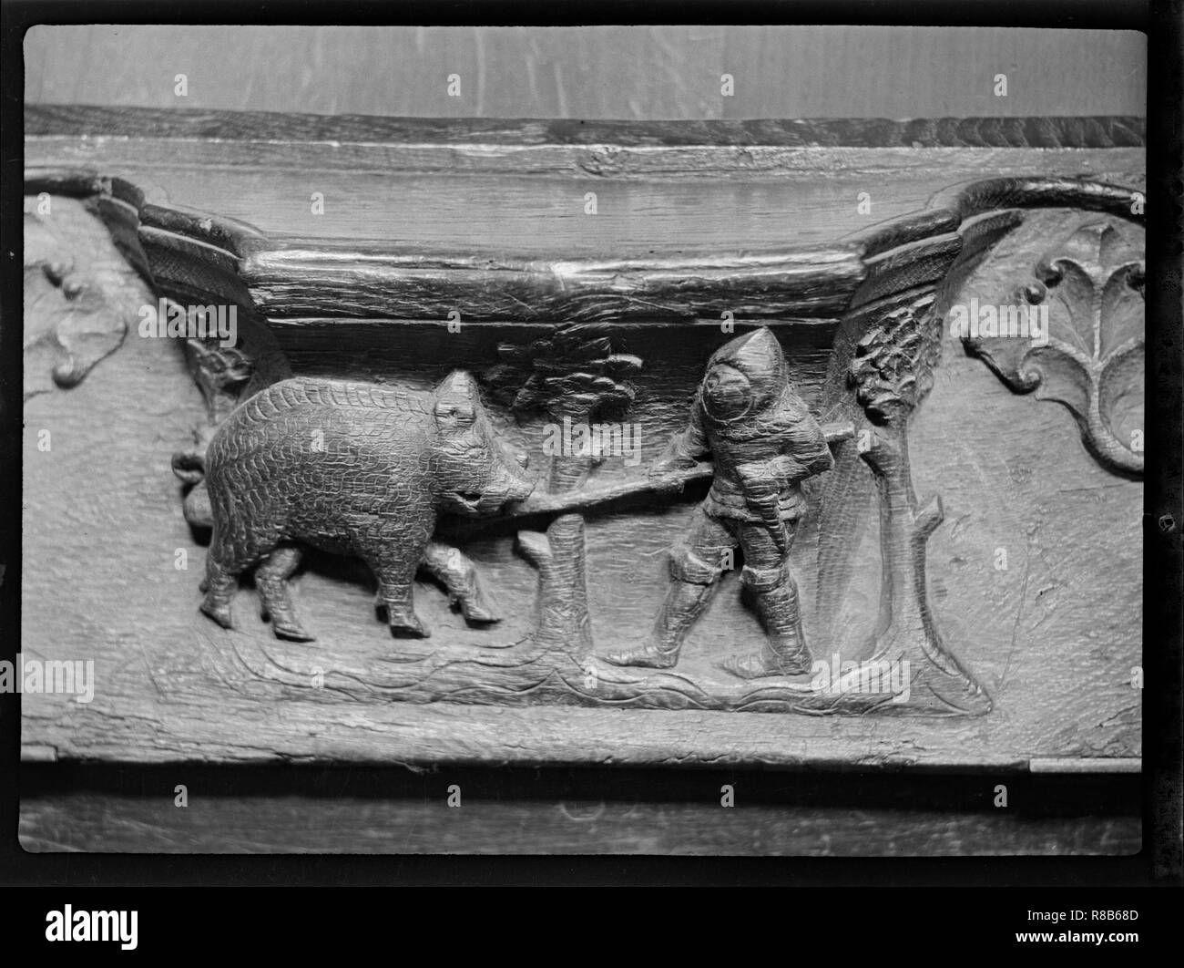 Misericord, St Mary's Church, North Bar Within, Beverley, East Riding of Yorkshire, 1920-1945. A misericord depicting a knight with a spear attacking  - Stock Image