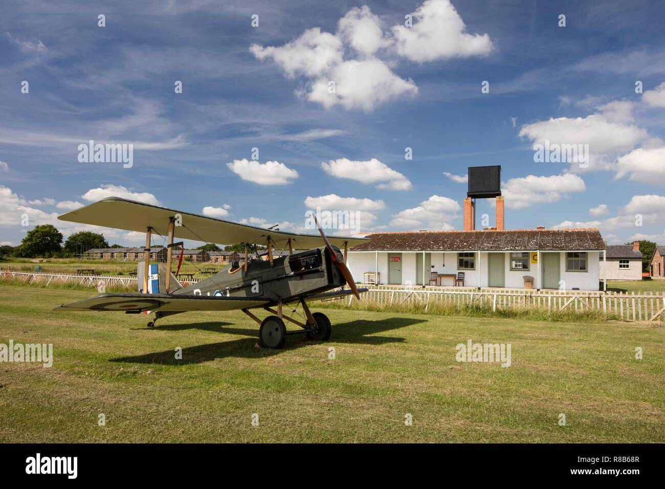 Stow Maries Aerodrome, Maldon, Essex, 2017. General view of the airfield site from the north-east, with a replica World War One aircraft in the foregr - Stock Image