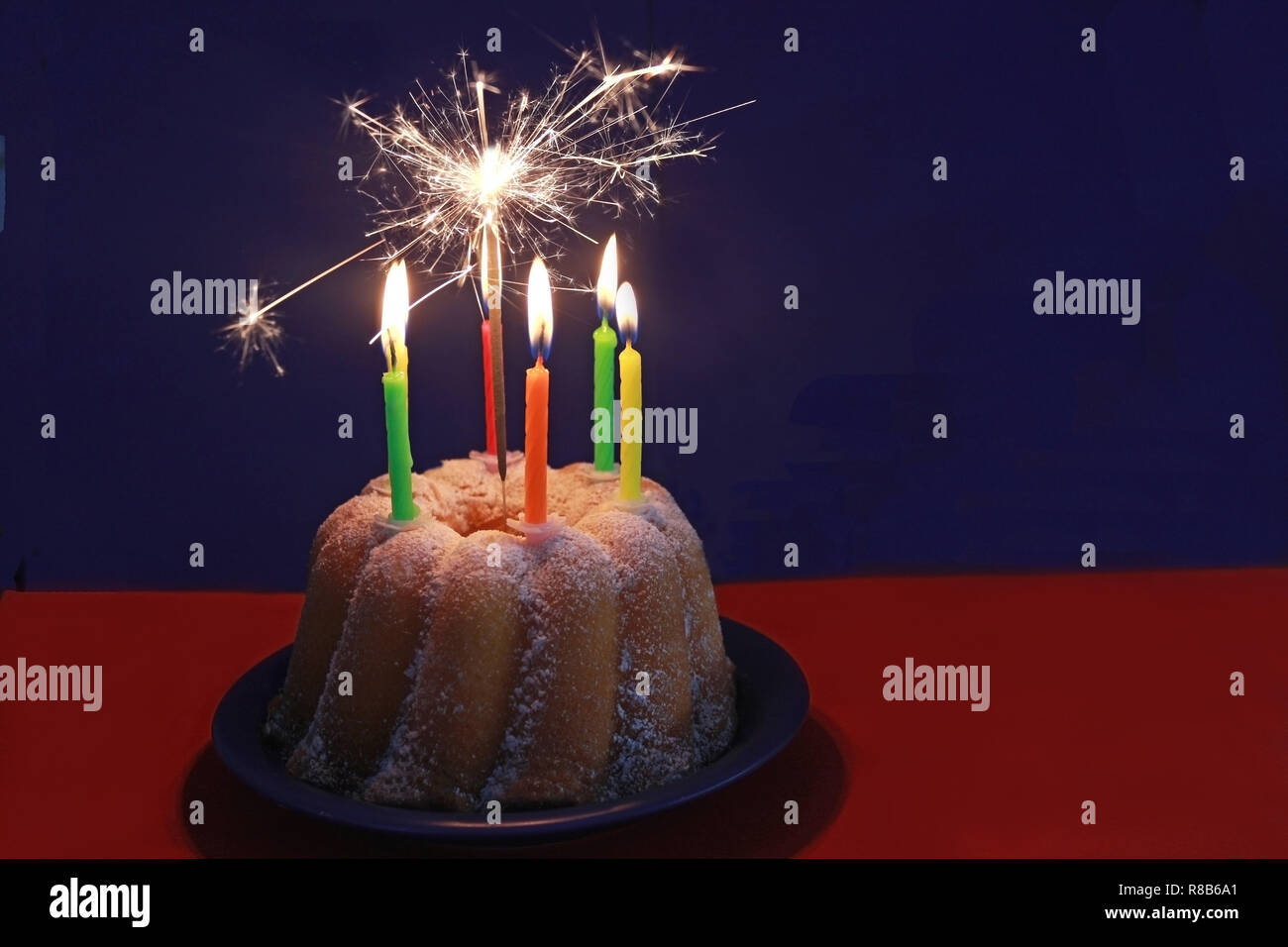 Birthday Cake For A Child With Burning Candles And Sparkler In Dark Room