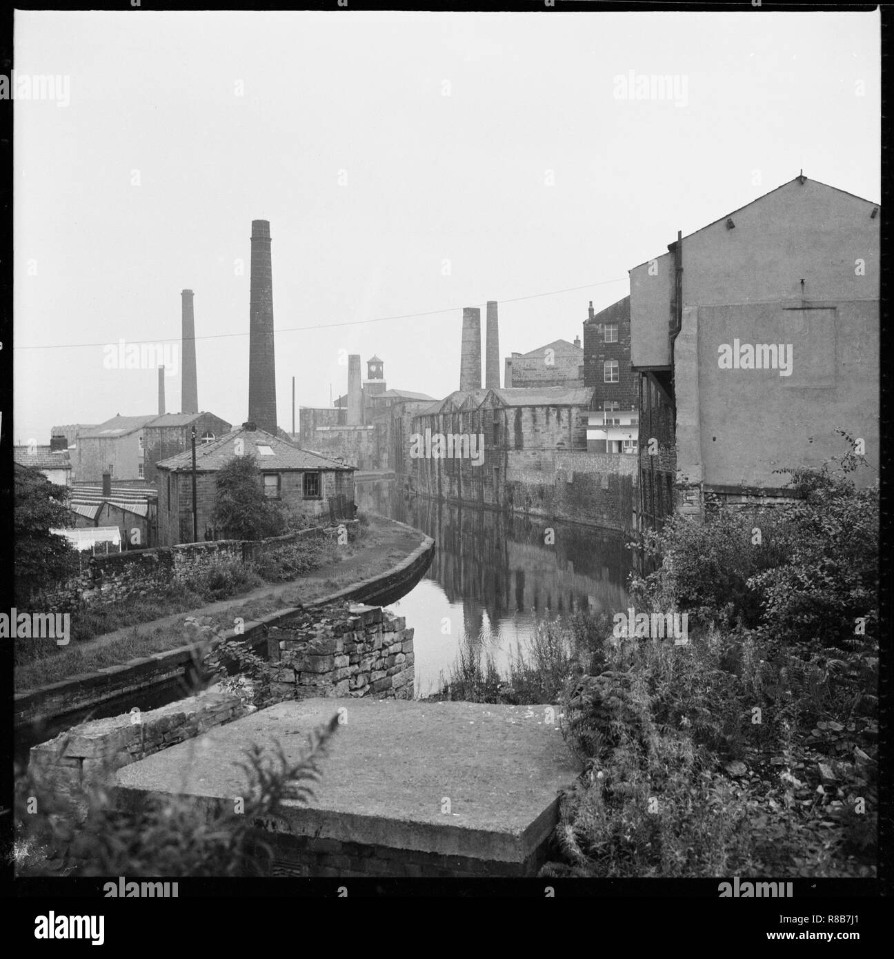 Weavers' Triangle, Burnley, Lancashire, 1966-1974. A view looking south-east along the Leeds and Liverpool Canal from Westgate Bridge showing mills an - Stock Image