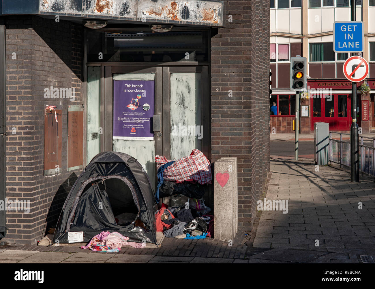 Tent of Homeless person in doorway of closed down Bank, centre of Stoke on Trent - Stock Image