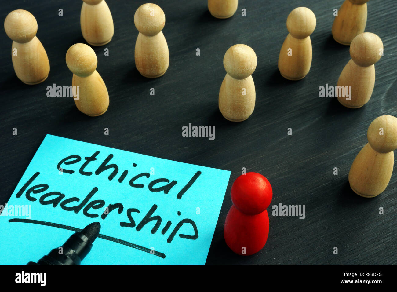 Ethical leadership. Wooden figures on a desk. - Stock Image