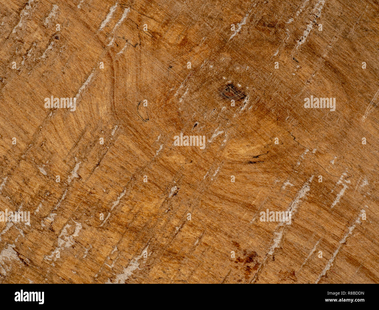 Old wooden brown plank with grooves and a weathered look. - Stock Image