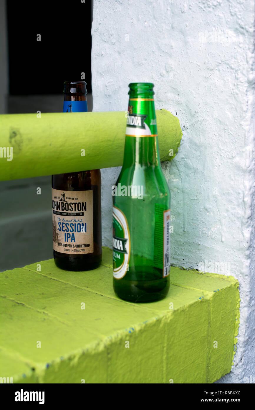 Empty beer bottles left on a wall, Brisbane, Queensland, Australia - Stock Image